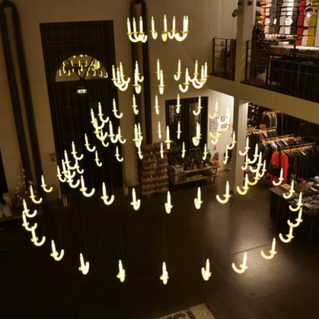 The levitating chandelier with porcelain candlesticks